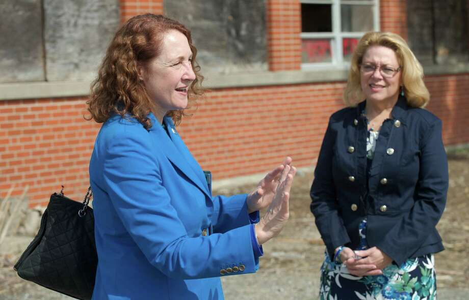 Congresswoman Elizabeth Esty, Connecticut 5th District, left, talks with New Milford Mayor Patricia Murphy at the Century Brass mill, in New Milford, Conn, where Esty announced a brownfield cleanup bill she is promoting, on Tuesday, April 22, 2014. Photo: H John Voorhees III / The News-Times Freelance