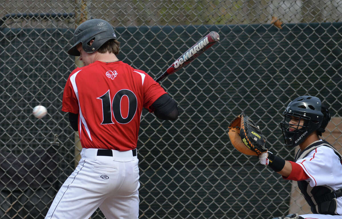 New Canaan's Dan Rajkowski takes a pitch in the Rams' game against Greenwich on Friday, April 11.