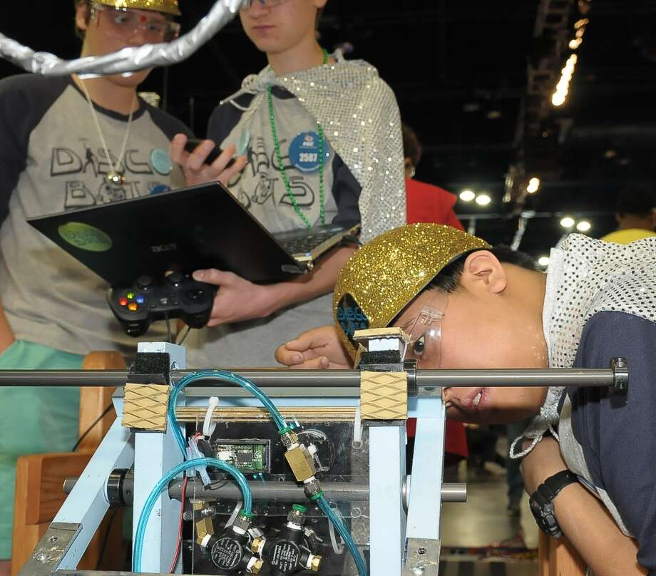 Andrew Nagal (16, junior) makes a few last minute adjustments to their robot before competing with the Lamar High School team in the VEX Robotics World Championships at the George R. Brown convention center Saturday 04/05/14. Photo: Â Tony Bullard 2014, Freelance Photographer / © Tony Bullard & the Houston Chronicle