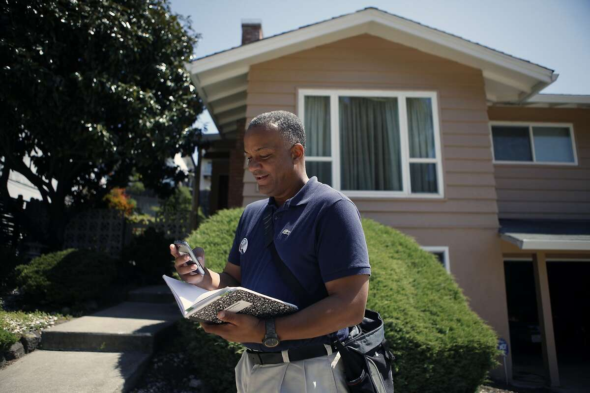 Oakland mayoral candidate Bryan Parker uses the Electionear phone app to help coordinate his campaign as he canvasses an East Oakland neighborhood.