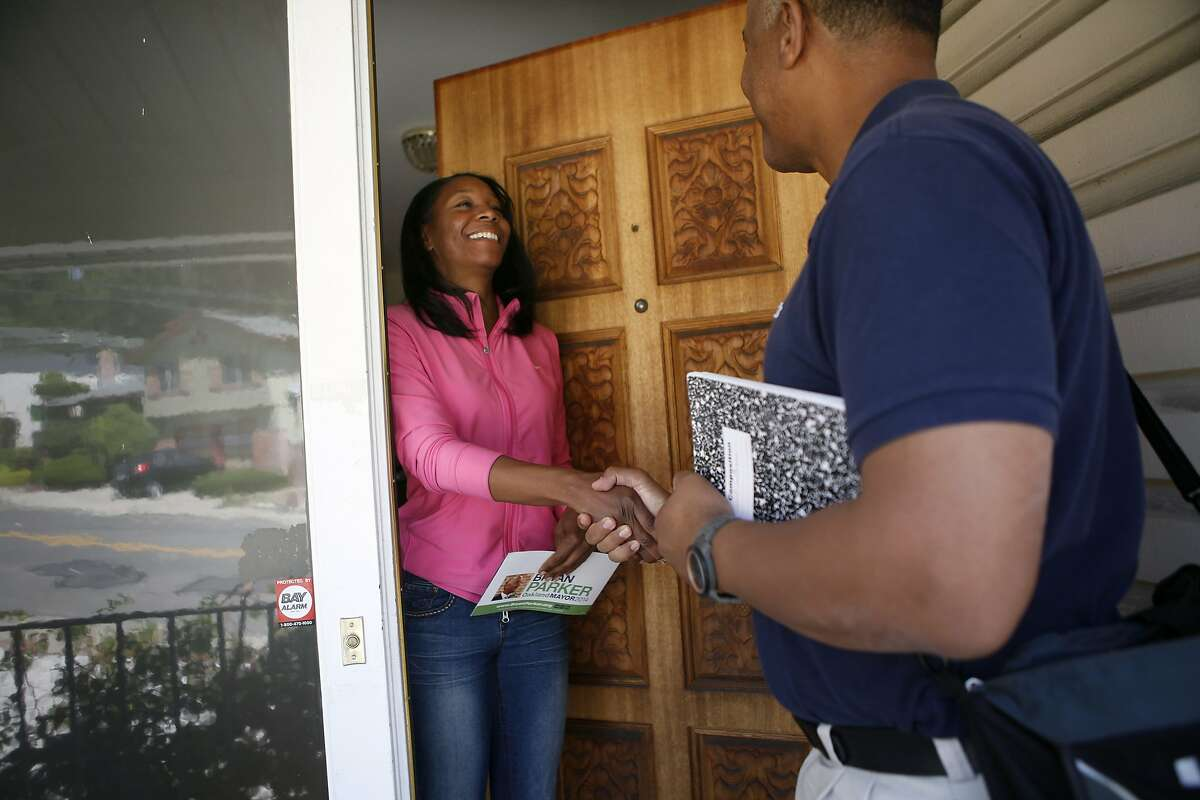 Oakland mayoral candidate Bryan Parker talks with resident Tanzanika Carter as he canvases door-to-door in support of his campaign in East Oakland, CA, Saturday April 19, 2014.