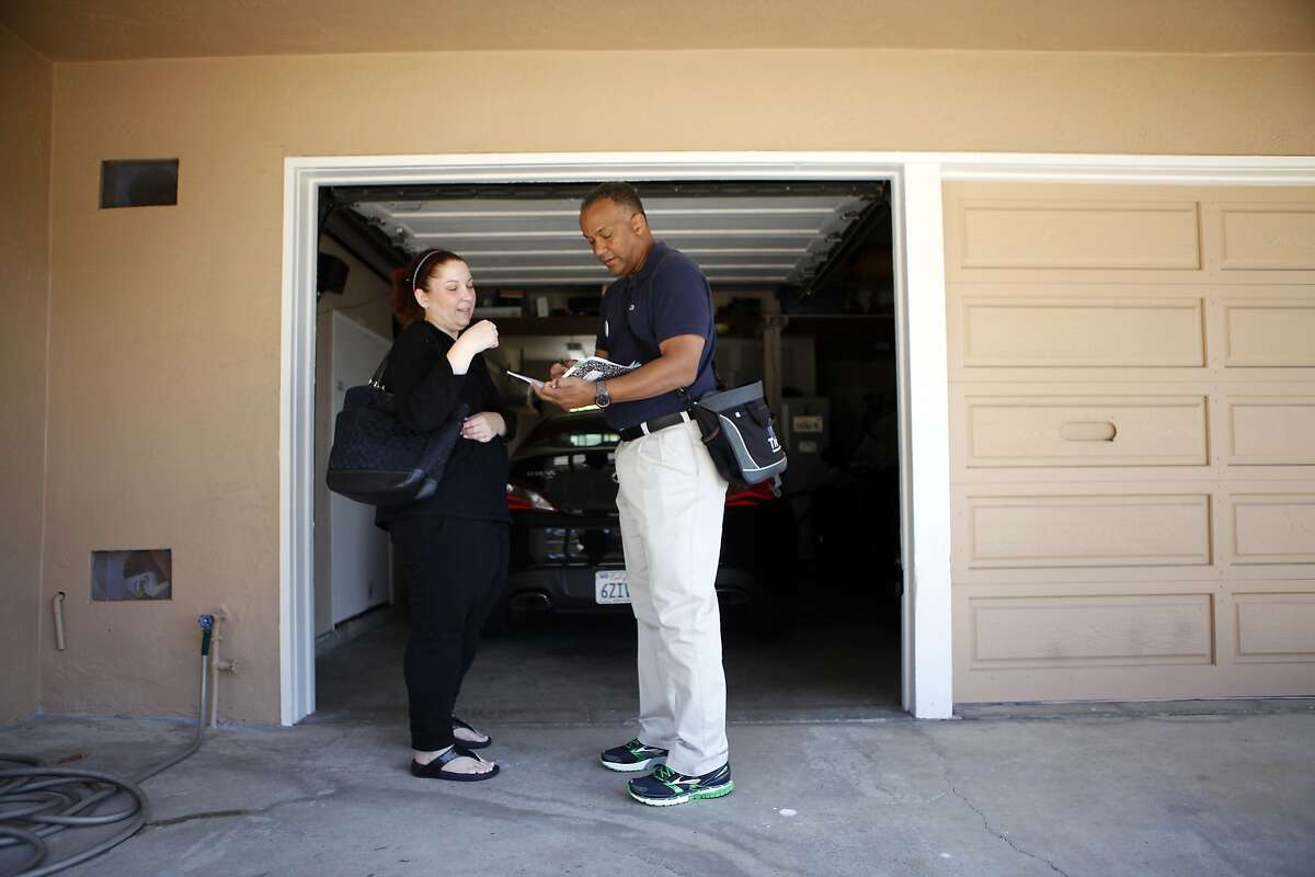Oakland mayoral candidate Bryan Parker talks with Carrie Williams as he canvases door-to-door in support of his campaign in East Oakland, CA, Saturday April 19, 2014.