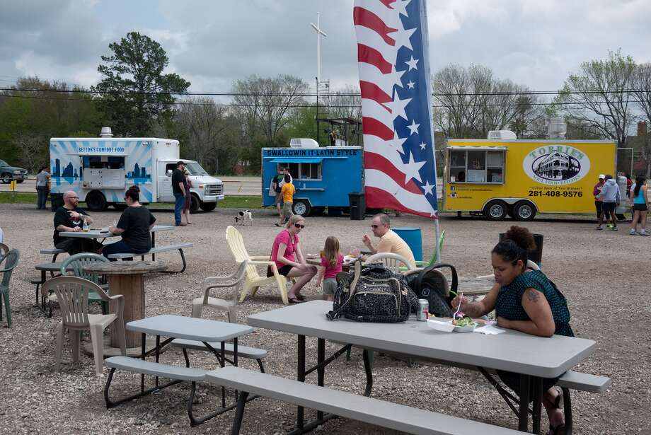 A line of as many as 18 colorful food trucks circles the dining area at My Food Trucks HTX on Saturdays. Photo: R. Clayton McKee, Freelance / © R. Clayton McKee