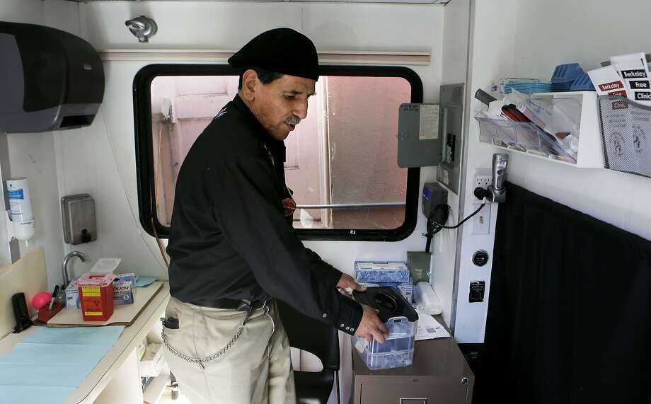 Orlando Chavez, fills a work station inside a mobile medical outreach van operated by the Berkeley Free Clinic, on Thursday April 10, 2014, in Berkeley, Calif., which does weekly on-the-street medical testing, including Hepatitis C. Chavez who was diagnosed with Hepatitis C in 1999 and underwent treatment successfully in 2004-2005, is now cured and works with patients at the Berkeley Free Clinic. The rising cost of breakthrough innovative drugs has vexed the United States for years. Patients have protested and politicians have pontificated but yet prices continue to soar. But a $1,000 a pill from Gilead Sciences in Foster City may just be the straw that broke healthcareÕs back. Since Gilead won approval from the FDA for Solvadi, a pill to treat Hepatitis C, the company has received push back from state reimbursement agencies and Congress. Photo: Michael Macor, The Chronicle