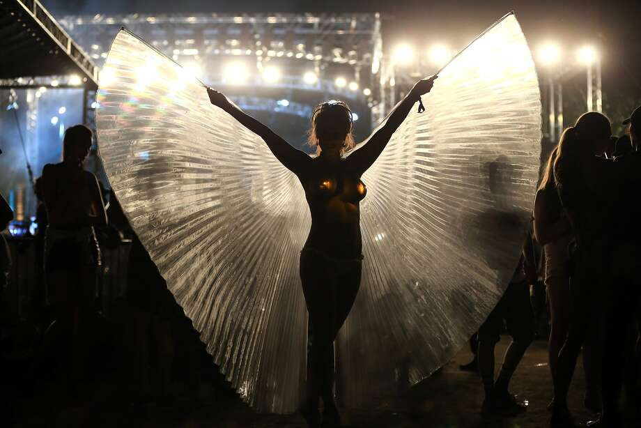 The wings of Isis: Music fan Isis Alize spreads her wings at the Coachella Valley Music & Arts Festival in Indio, Calif. Photo: Christopher Polk, Getty Images For Coachella