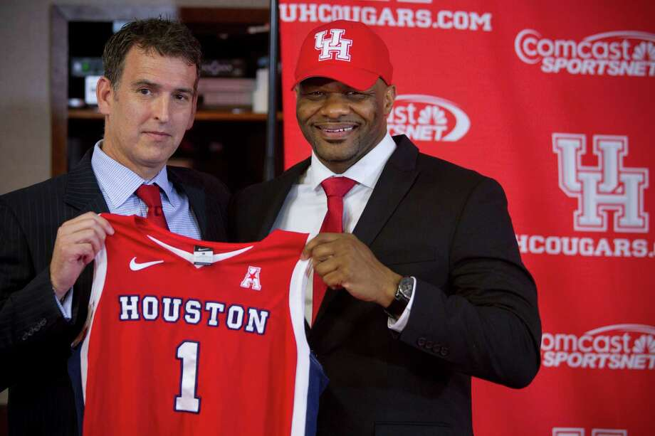 Mack Rhoades, vice president for Intercollegiate Athletics at the University of Houston, left, poses for photos with Ronald Hughey  as Hughey is introduced at the new head women's basketball coach at UH during a news conference Tuesday, April 22, 2014, in Houston. Photo: Brett Coomer, Houston Chronicle / © 2014 Houston Chronicle