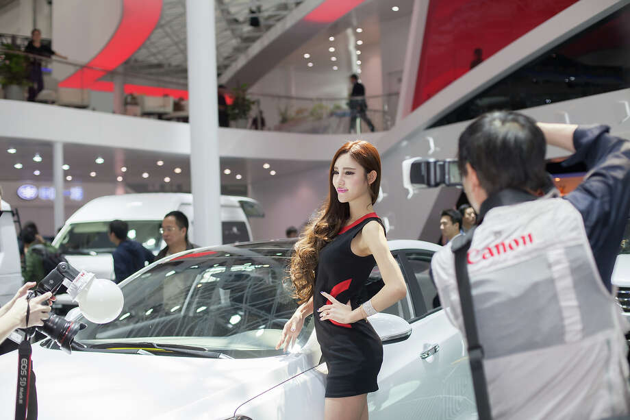 People take pictures at the 2014 Beijing International Automotive Exhibition on April 21, 2014 in Beijing, China.  Photo: Xiao Lu Chu, Wire Images / 2014 Xiao Lu Chu
