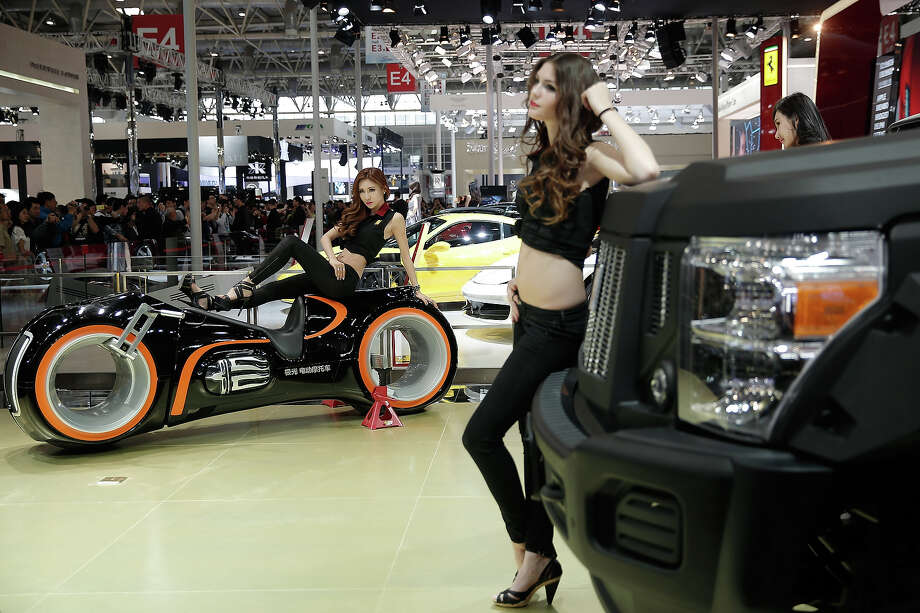 Models stand beside G.Patton vehicle during the 2014 Beijing International Automotive Exhibition at China International Exhibition Center on April 22, 2014 in Beijing, China. More than 2,000 automotive enterprises from 14 countries and regions participated in the 2014 Beijing International Automotive Exhibition from April 20 to April 29. Photo: Lintao Zhang, Wire Images / 2014 Getty Images