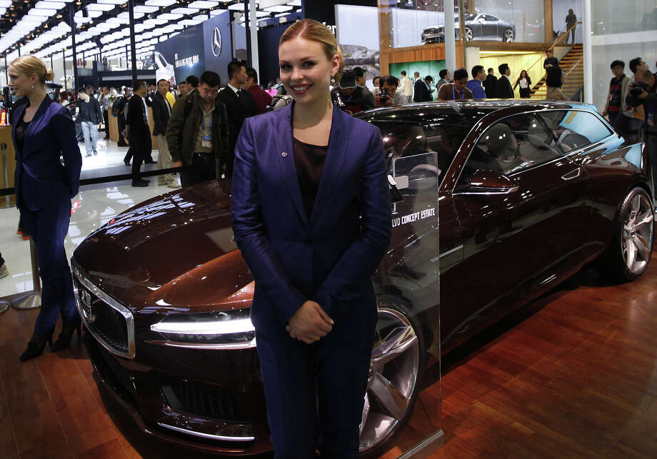 "A model poses besides a Volvo car on display at the China International Exhibition Center new venue during the ""Auto China 2014"" Beijing International Automotive Exhibition in Beijing on April 20, 2014.  Leading automakers are gathering in Beijing for the kickoff of China's biggest car show, but lackluster growth and environmental restrictions in the world's largest car market have thrown uncertainty into the mix. More than 1,100 vehicles are being showcased at the auto show, which opens to the public on April 21. Photo: AFP, Wire Images / AFP"