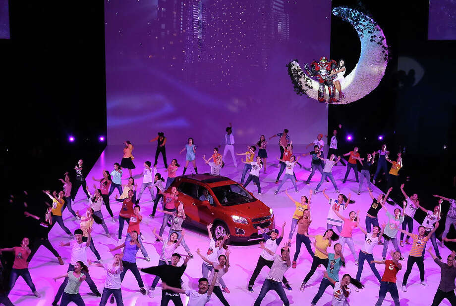 "This picture taken on April 19, 2014 shows dancers performing around a new Chevrolet Trax car during the ""Chevrolet Gala Night"", ahead of the ""Auto China 2014"" Beijing International Automotive Exhibition in Beijing.  Leading automakers are gathering in Beijing for the kickoff of China's biggest car show, but lackluster growth and environmental restrictions in the world's largest car market have thrown uncertainty into the mix. More than 1,100 vehicles are being showcased at the auto show, which opens to the public on April 21. Photo: STR, Wire Images / AFP"