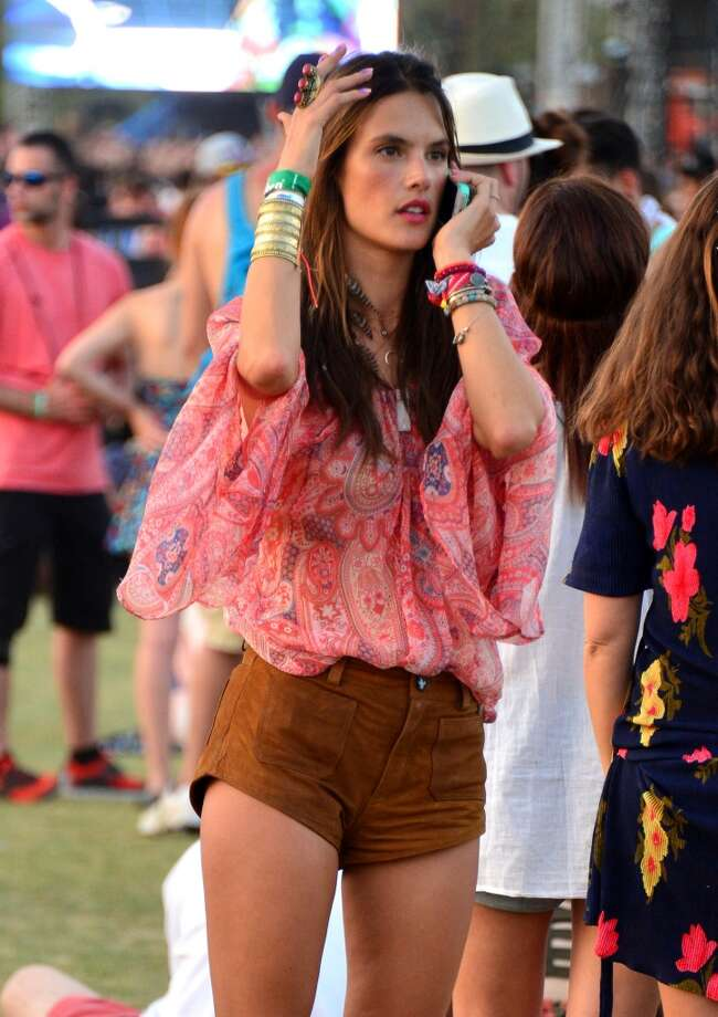 Taking your kid to a alcohol-fueled music festival, as model Alessandra Ambrosio did at Coachella. Photo: Frazer Harrison