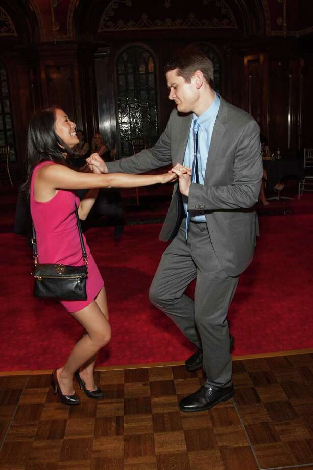 Jackie Hu and Michael Morgan shake things up at the Spinsters of San Francisco Annual Patrons Reception on April 14, 2014. Photo: Drew Altizer, Drew Altizer Photography
