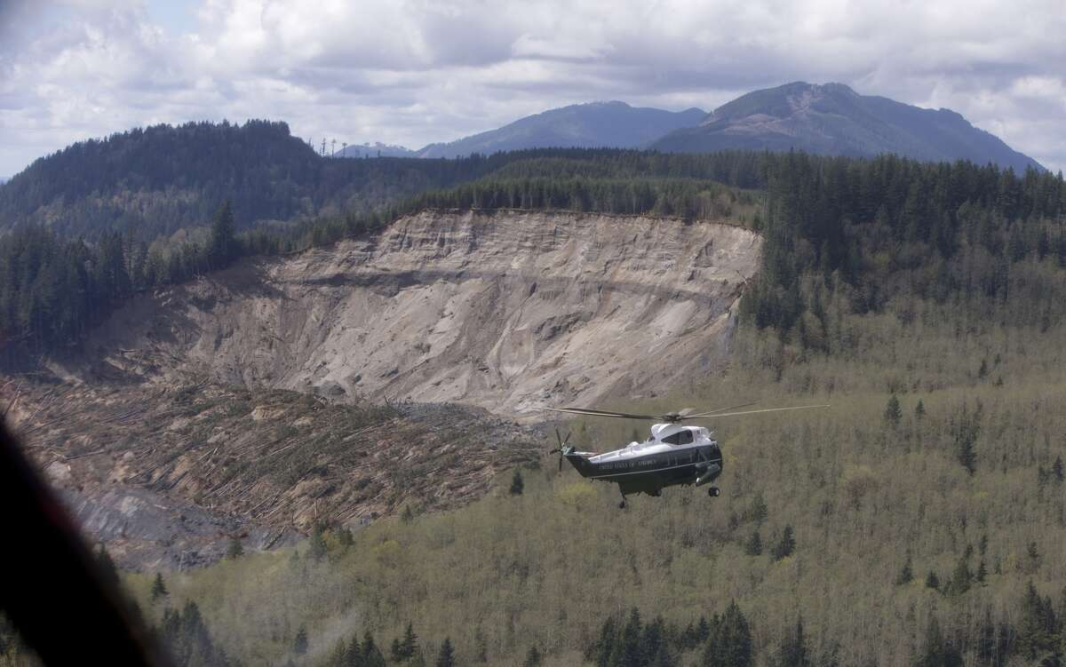 Marine One, carrying President Barack Obama, takes an aerial tour of Oso on Tuesday, April 22, 2014.