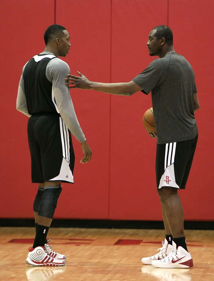Rockets center Dwight Howard left, works out with former Rockets center and NBA Hall of Famer Hakeem Olajuwon during the team's practice session Tuesday at the Toyota Center. Photo: James Nielsen, Houston Chronicle