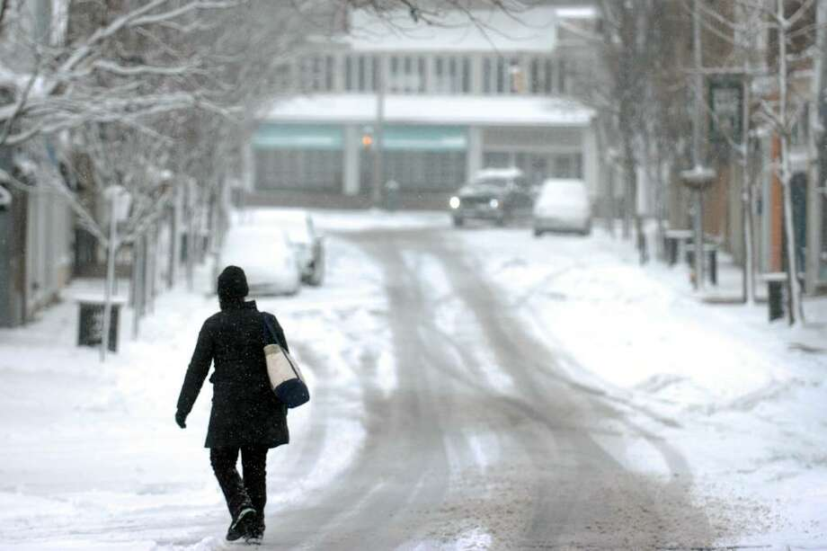 A lone pedestrian walks down an empty Main St., in Westport, Conn. at noon on Wed. Feb. 10th, 2010. Photo: Ned Gerard / Connecticut Post