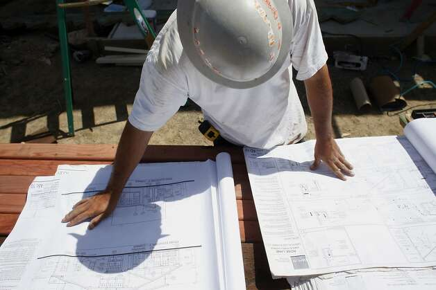 Foreman Efren Castillo looks over blueprints at the building site near Hall Middle School in central Larkspur. Photo: Lacy Atkins, SFC
