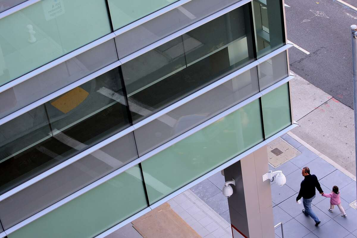 A dental school on 5th Street is one of four buildings in San Francisco that has shed its outer concrete layer in exchange for sleek glass in San Francisco, Calif. on April 19, 2014.