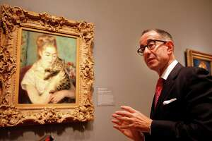 "Outgoing FAMSF Director Colin Bailey, a recognized scholar of Auguste Renoir, with the artist's ""Woman and a Cat."""