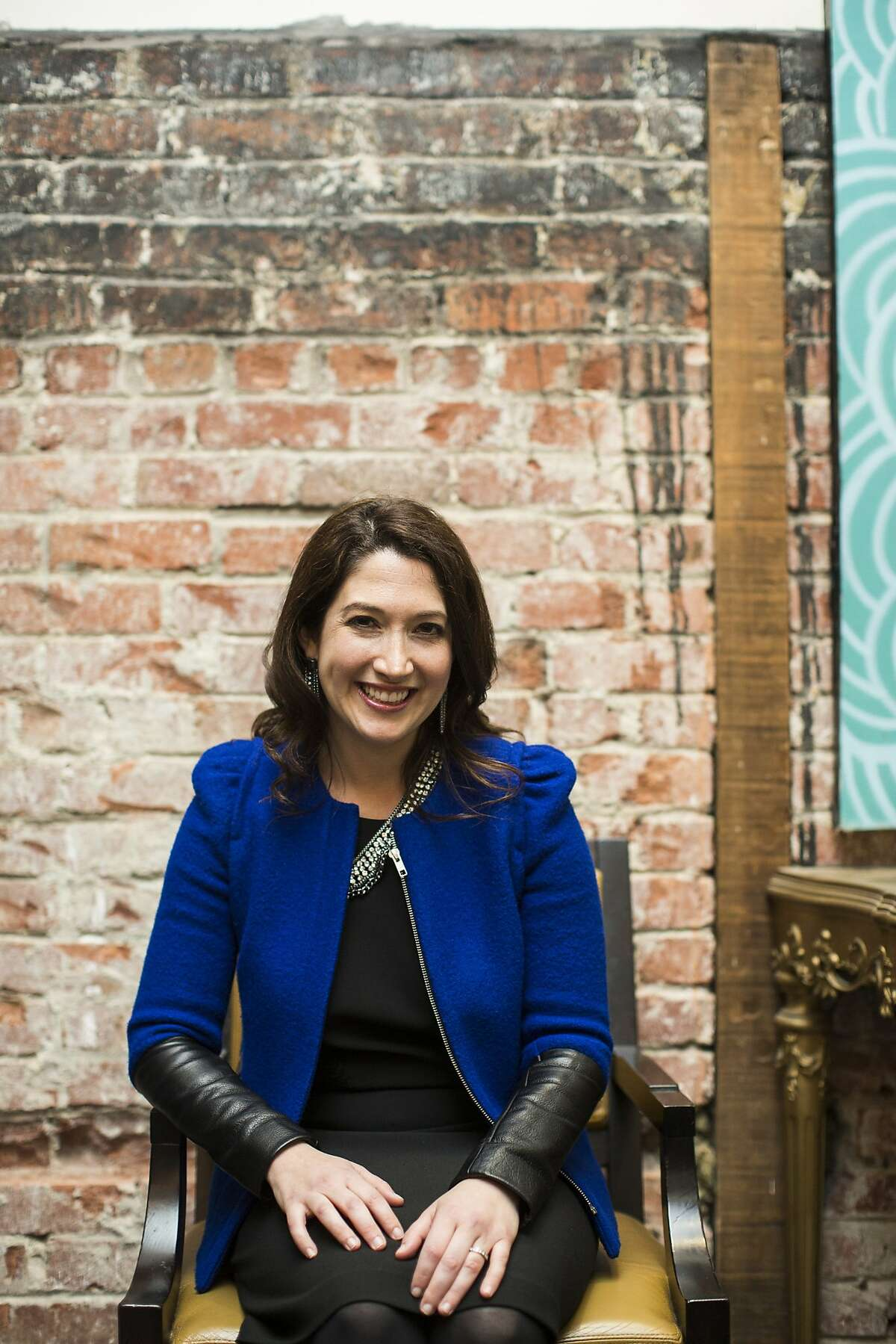 Randi Zuckerberg, sister of Facebook founder Mark Zuckerberg, CEO of Zuckerberg Media and Editor-in-Chief of Dot Complicated, poses for a photo before speaking at an event organized by Birthright Israel Foundation at Firehouse 8 in San Francisco, Calif. on Thursday, Feb. 20, 2014.