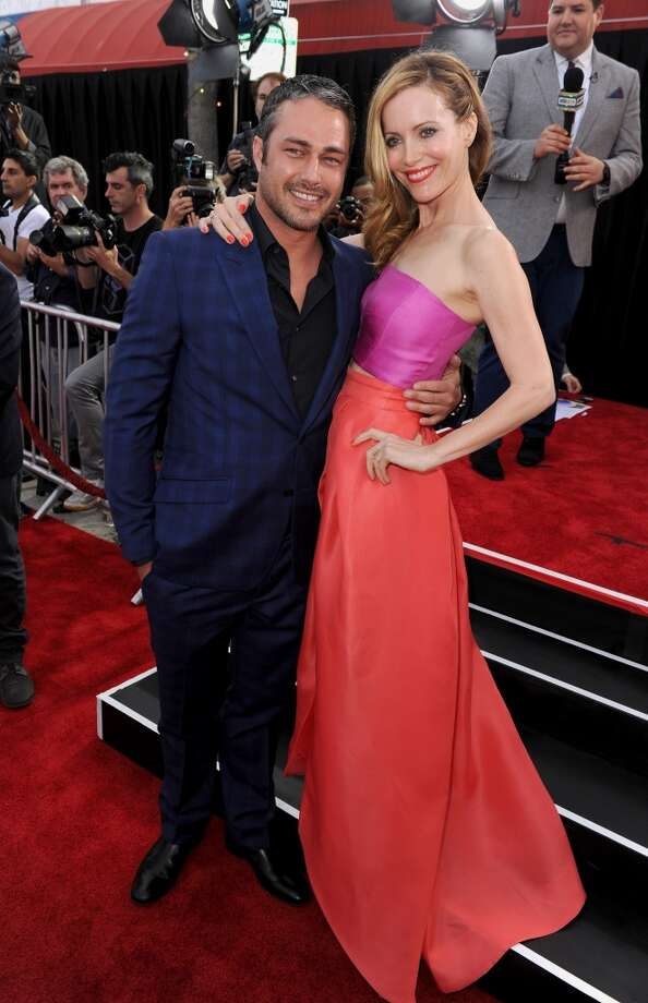 "Actors Taylor Kinney (L) and Leslie Mann attend the premiere of Twentieth Century Fox's ""The Other Woman"" at Regency Village Theatre on April 21, 2014 in Westwood, California. Photo: Kevin Winter, Getty Images"
