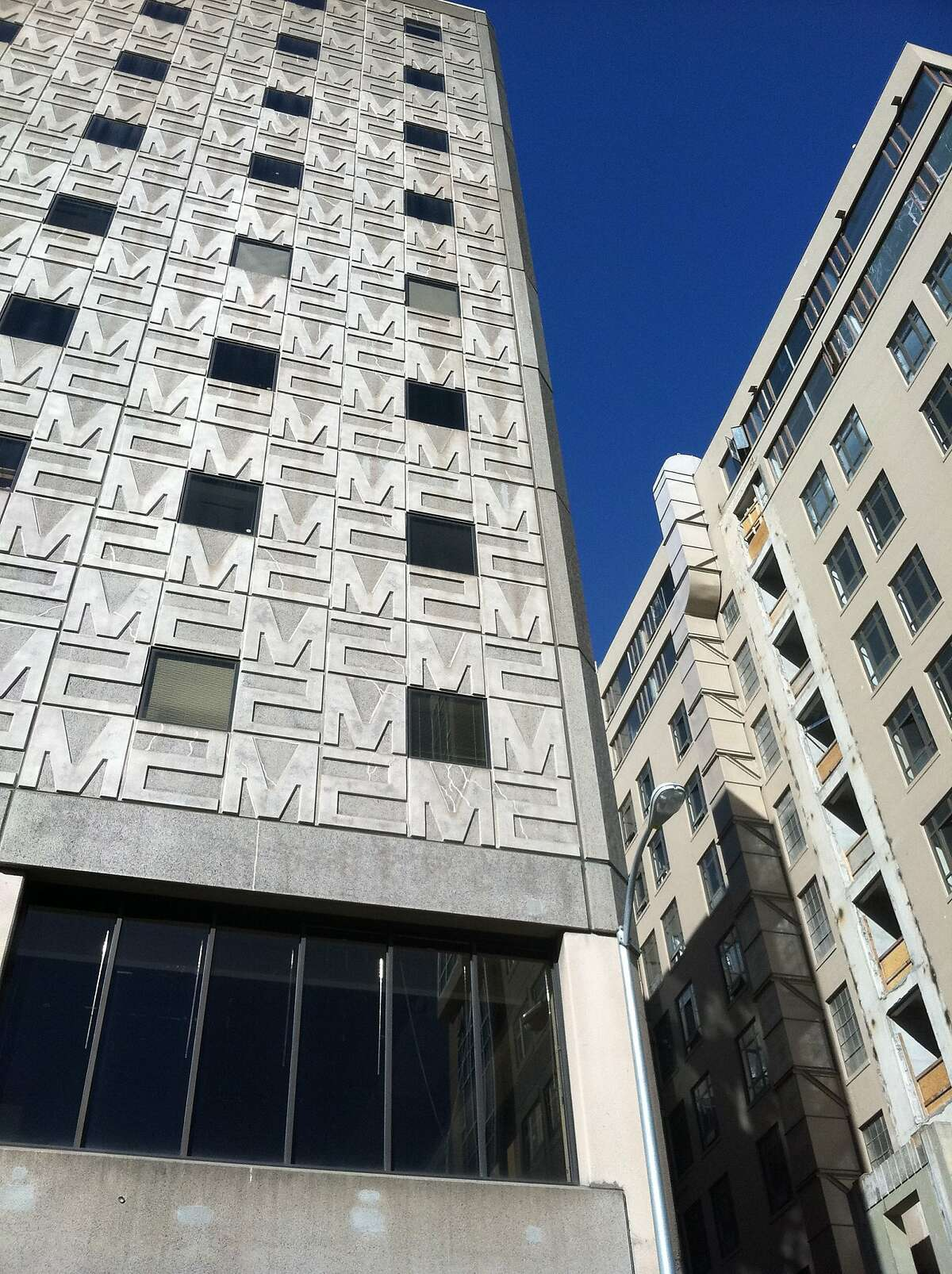 Now in the process of being named 1 10th Street, with a new glass skin, the 1970s addition to the Merchandise Mart was of note mainly for its small windows and logo'd M2 panels.