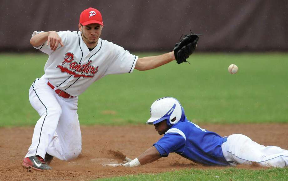 Pomperaug second baseman Nick Sarno bobbles the ball as Bunnell baserunner Matt Alcantora slides safely into second base in Bunnell's win over Pomperaug in the high school baseball game at Pomperaug High School in Southbury, Conn. Tuesday, April 22, 2014. Photo: Tyler Sizemore / The News-Times