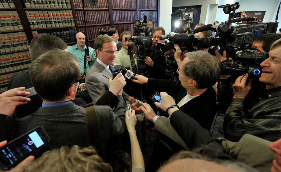 Michigan Attorney General Bill Schuette, center left, speaks about the United States Supreme Court's decision, Tuesday, April 22, 2014, regarding the state's Affirmative Action law involving college admissions, during a news conference in Lansing, Mich. Photo: Dale G. Young, MBO / The Detroit News