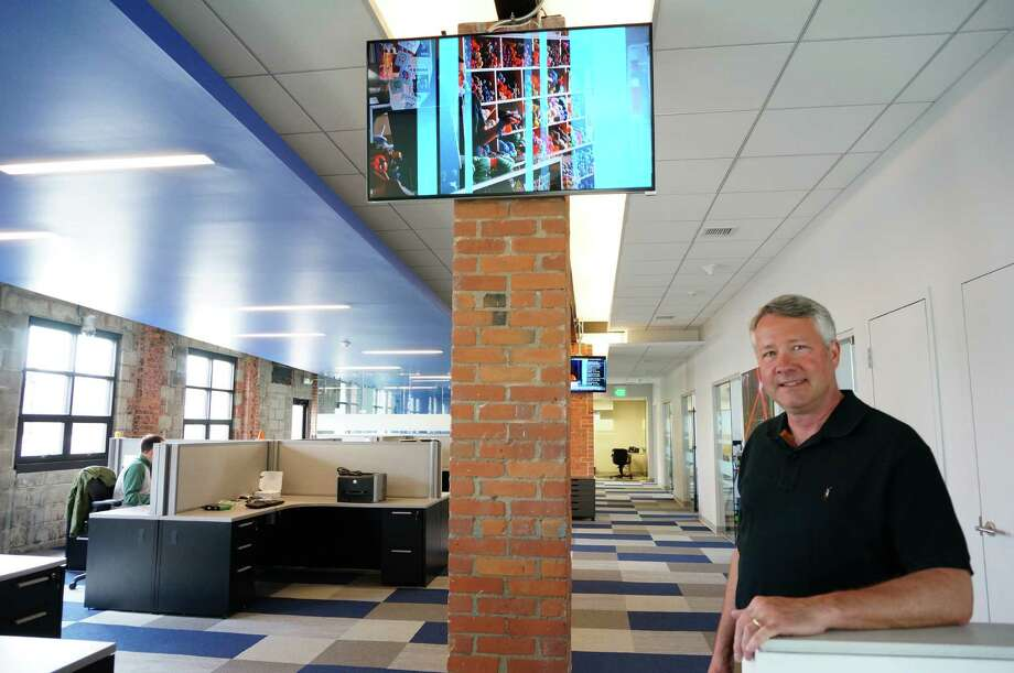 "David Ives, founder and CEO of TVEyes, calls the service his company offers ""Google for TV."" Ives is seen inside the company's new downtown headquarters, from which it plans to launch an expansion into new foreign markets. Photo: Geneive Reilly/Fairfield Citizen / Fairfield Citizen"