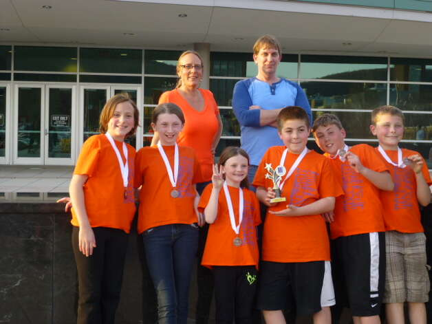 """The Green Meadow Elementary School won first place in the Odyssey of the Minds Regional Competition held at Rensselaer High School on March 8. They then competed in the state finals at Binghamton University on April 12 where they finished third out of 18 teams. They competed in Problem #2 """"The Not So Haunted House"""" Division #1 (third to fifth grade). Here, are   Bella Dupont, Haley Snedaker, Alex Snedaker, Lucus Church, Simon O'Connor and Nate Desany celebrate at Binghamton with team coaches  Melissa Dupont and Gary Snedaker. (Submitted photo)   (Submitted photo)"""
