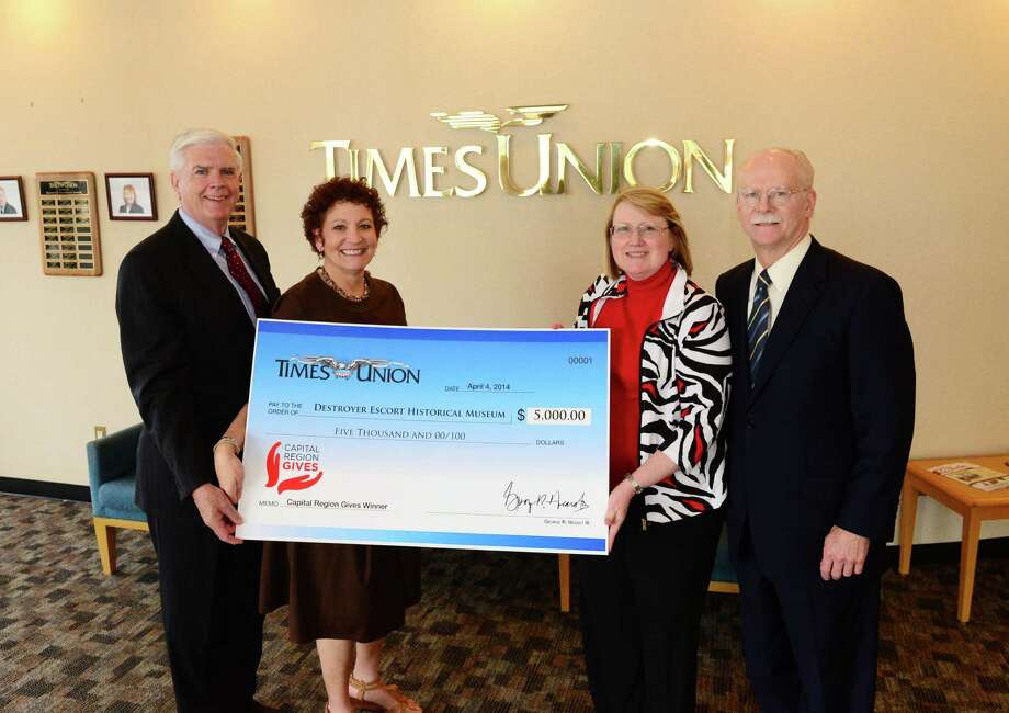 The USS Slater won the second Capital Region Gives promotion and received $5,000 in cash plus $5,000 of in-kind advertising from the Times Union. Pictured at the Times Union from left: B.J. Costello, chairman of the Destroyer Escort Historical Museum Board of Trustees; Times Union Community Relations Manager Charmaine Ushkow; Rosehn Gipe, USS Slater business manager; and George R. Hearst III, publisher and CEO of the Times Union. (Will Waldron/Times Union)