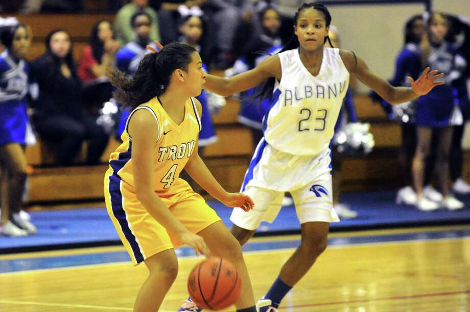 Troy's Kiana Patterson, left, controls the ball as Albany's Mylah Chandler defends during their basketball game on Friday, Feb. 7, 2014, at Albany High in Albany, N.Y.  (Cindy Schultz / Times Union) Photo: Cindy Schultz / 00025676A
