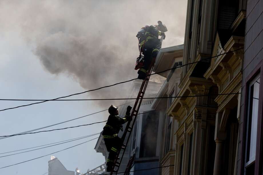 SFFD responded to a three-alarm fire that burned three residences on Walter Street in San Francisco, Calif., Tuesday, April 22, 2014. The fire broke out around 1:30 p.m. under strong winds. Photo: Jason Henry, Special To The Chronicle
