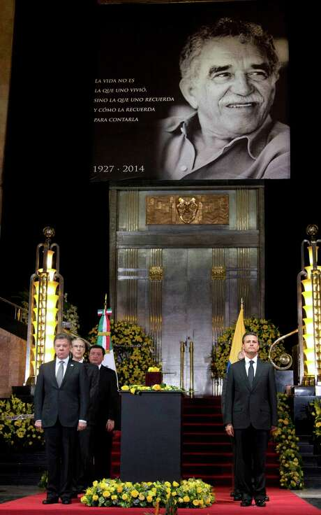 Colombia's President Juan Manuel Santos, left, and Mexico's President Enrique Pena Nieto, stand next to the urn containing the ashes of Colombian Nobel Literature laureate Gabriel Garcia Marquez during the authors homage at the Palace of Fine Arts in Mexico City, Monday, April 21, 2014. Garcia Marquez died on Thursday at his home in Mexico City. His magical realist novels and short stories exposed tens of millions of readers to Latin America's passion, superstition, violence and inequality. (AP Photo/Eduardo Verdugo) Photo: Eduardo Verdugo, STF / AP