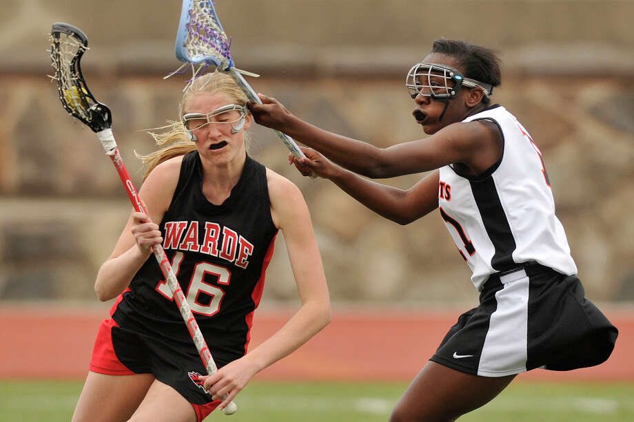 Fairfield Warde's Grace Orben is hit in the head by Stamford's Britney Moise during their game at Stamford High School in Stamford, Conn., on Tuesday, April 22, 2014. Fairfield Warde won, 12-6. Photo: Jason Rearick / Stamford Advocate