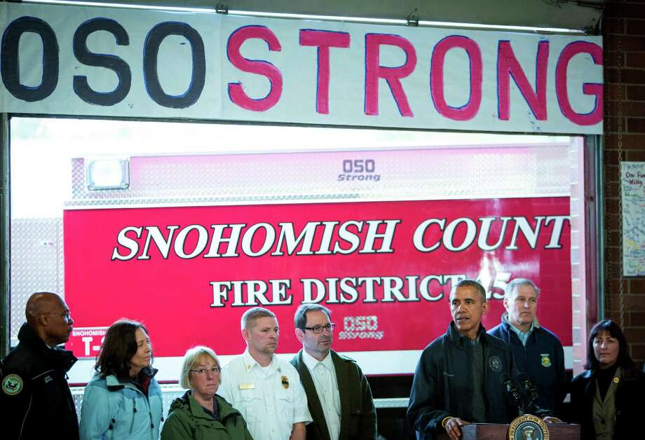 President Barack Obama speaks at the Oso Fire Station. Behind Obama are, from left, Snohomish County Executive John Lovick, Senator Maria Cantwell, Senator Patty Murray, Oso Fire Chief Will Parker, Darrington Mayor Dan Rankin, Governor Jay Inslee and Representative Suzan DelBene. Photographed on Tuesday, April 22, 2014. Photo: JOSHUA TRUJILLO, SEATTLEPI.COM / SEATTLEPI.COM