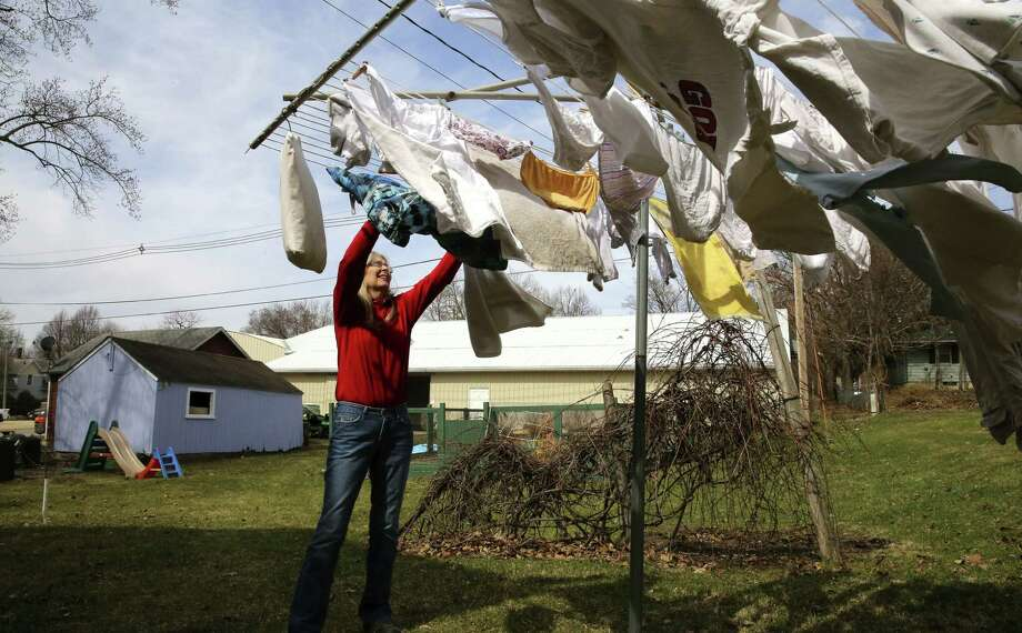 Kathy Washburn works on laundry at home during a lunch break from her job at a nearby Ace Hardware in Mount Vernon, Iowa, where she makes $33,000 a year. Lower- and middle-income Americans are no longer the richest in that group worldwide. Photo: Nicole Bengiveno / New York Times / NYTNS