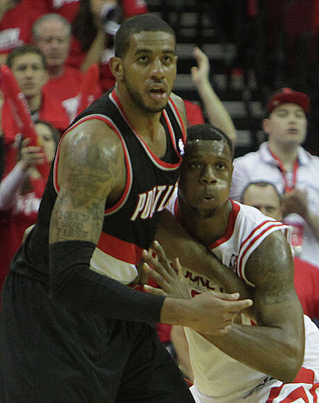 With Terrence Jones, right, struggling against LaMarcus Aldridge in Game 1, the Rockets are considering other defensive options. Photo: James Nielsen, Staff / © 2014  Houston Chronicle