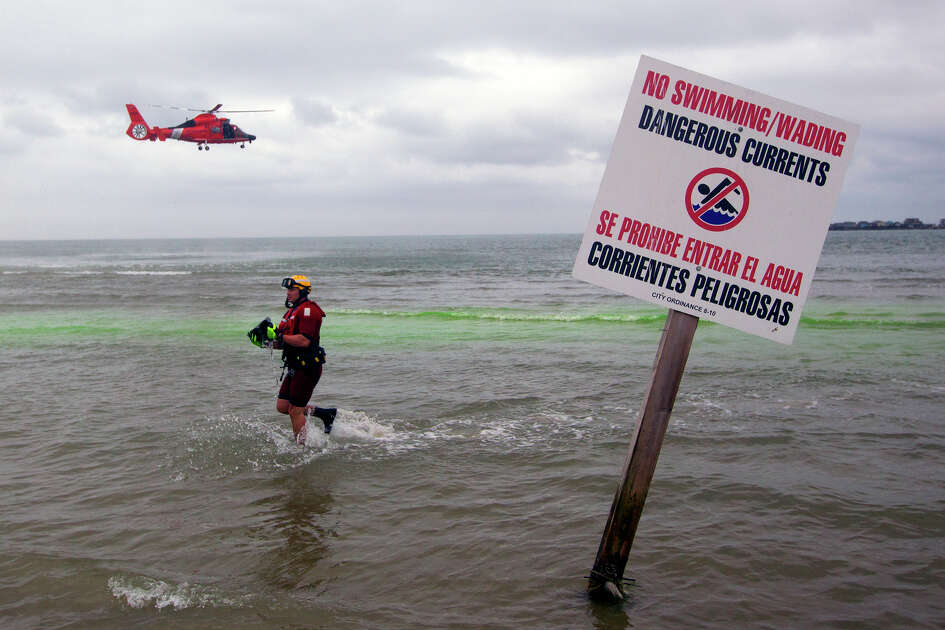 Coast Guard Chief Charles Ferrante exits the water during water rescue training through San Luis Pass, Tuesday, April 22, 2014, in Galveston. Search crews were looking in the area for a man who was reported missing after going swimming early Sunday, May 26, 2019.