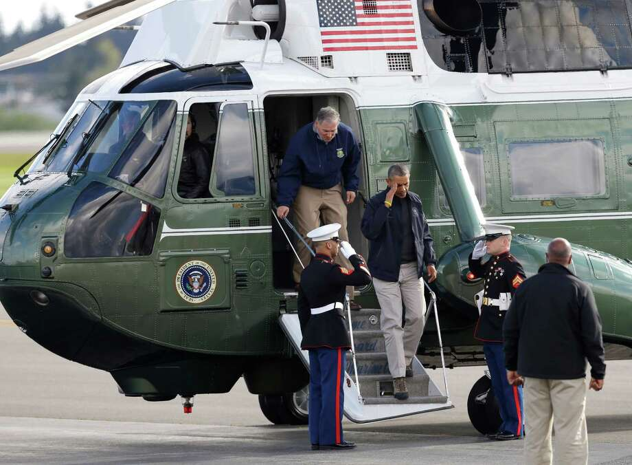 President Barack Obama salutes as he leaves Marine One with Washington Gov. Jay Inslee behind him, Tuesday, April 22, 2014, at Paine Field in Everett, Wash., after visiting the community of Oso, Wash., which was hit by a deadly mudslide on March 22, 2014. Photo: Ted S. Warren, AP / AP