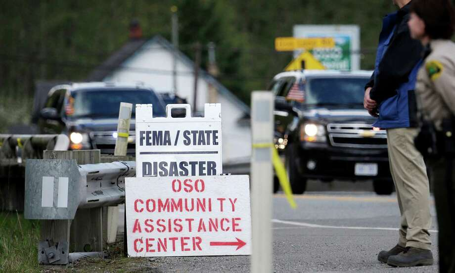 President Barack Obama's motorcade approaches the Oso fire station Tuesday, April 22, 2014, in Oso, Wash. Obama was visiting the area about an hour northeast of Seattle to survey damage from a recent mudslide nearby that killed more than three dozen people. The deadly March 22 mudslide killed at least 41 people and buried dozens of homes.  Photo: Elaine Thompson, ASSOCIATED PRESS / AP2014