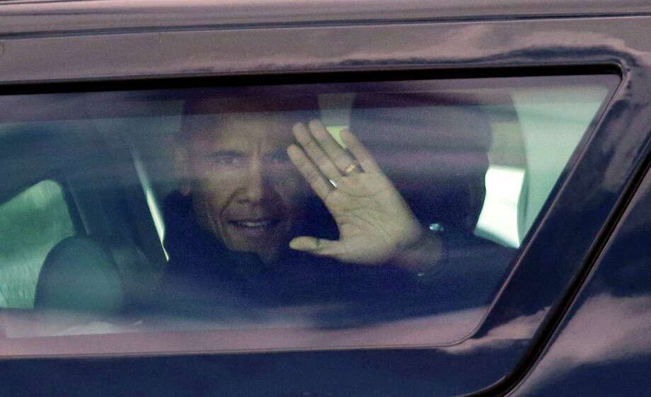 President Barack Obama waves from his car as his motorcade drives past after he met with emergency responders Tuesday, April 22, 2014, in Oso, Wash. Obama was visiting the area about an hour northeast of Seattle to survey damage from a recent mudslide nearby that killed more than three dozen people. The deadly March 22 mudslide killed at least 41 people and buried dozens of homes.  Photo: Elaine Thompson, ASSOCIATED PRESS / AP2014
