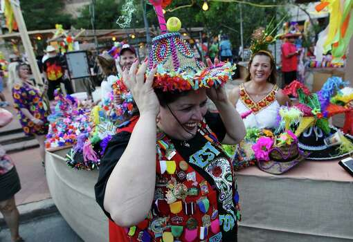 Marty Rice tries on a festive hat at the kickoff of 2014 Night In Old San Antonio (NIOSA) on Tuesday, Apr. 22, 2014. Rice has attended NIOSA for 25 years. Photo: Kin Man Hui, San Antonio Express-News / ©2014 San Antonio Express-News