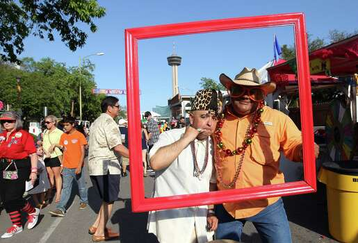 Alex Cordova (left) and Joe Rea goof off with a picture frame near the cotton candy booth at the kickoff of 2014 Night In Old San Antonio (NIOSA) on Tuesday, Apr. 22, 2014. Photo: Kin Man Hui, San Antonio Express-News / ©2014 San Antonio Express-News