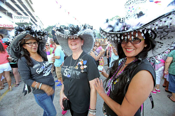Nora Gaitan (from left), Mary Phillips and Lisa Cano enjoy attention as NIOSA kicks off on April 22, 2014.
