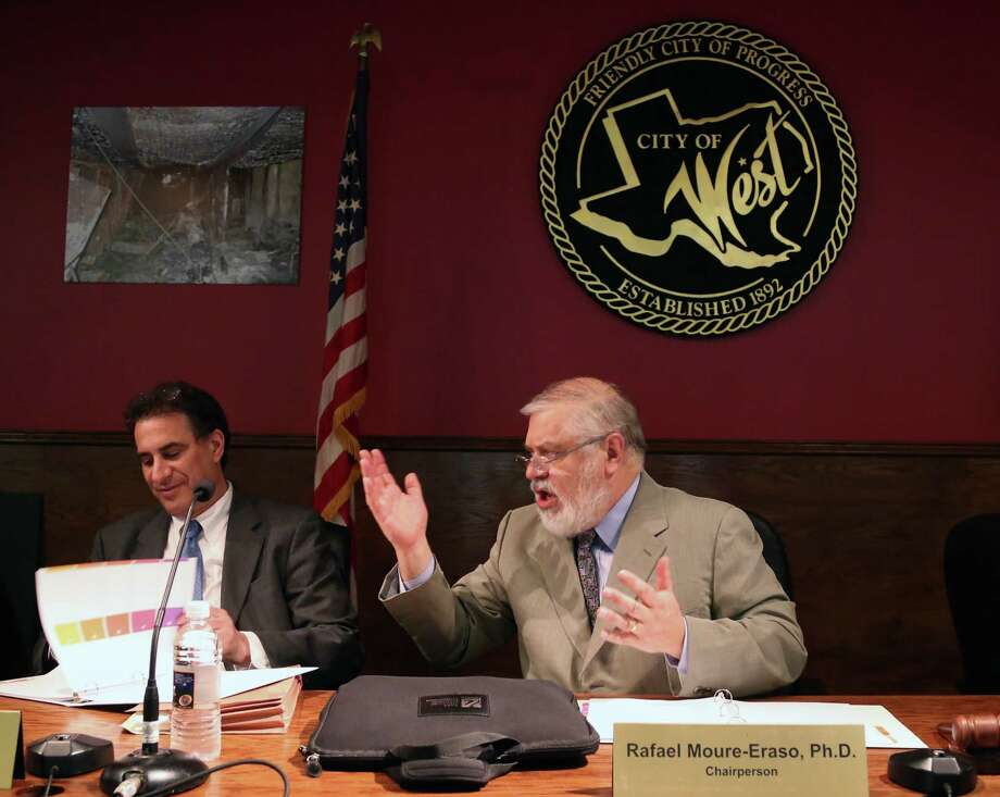 Rafael Moure-Eraso, right, U.S. Chemical Safety Board chairman, told West residents that state and federal rules should limit ammonium nitrate storage. Photo: Rod Aydelotte, MBO / Waco Tribune Herald