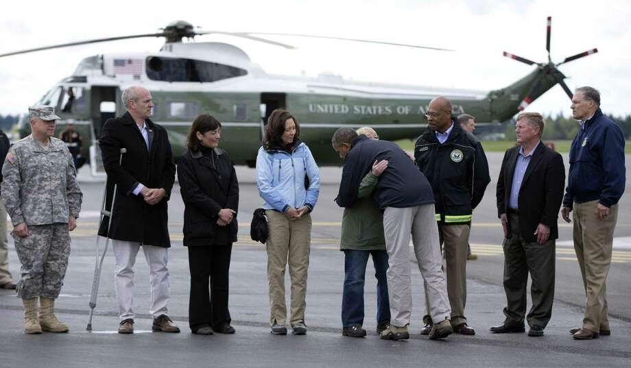 President Barack Obama is welcomed at  Paine Field Airport  in Everett, Wash., en route to Oso, the site of the deadly mudslide. Photo: Carolyn Kaster / Associated Press / AP