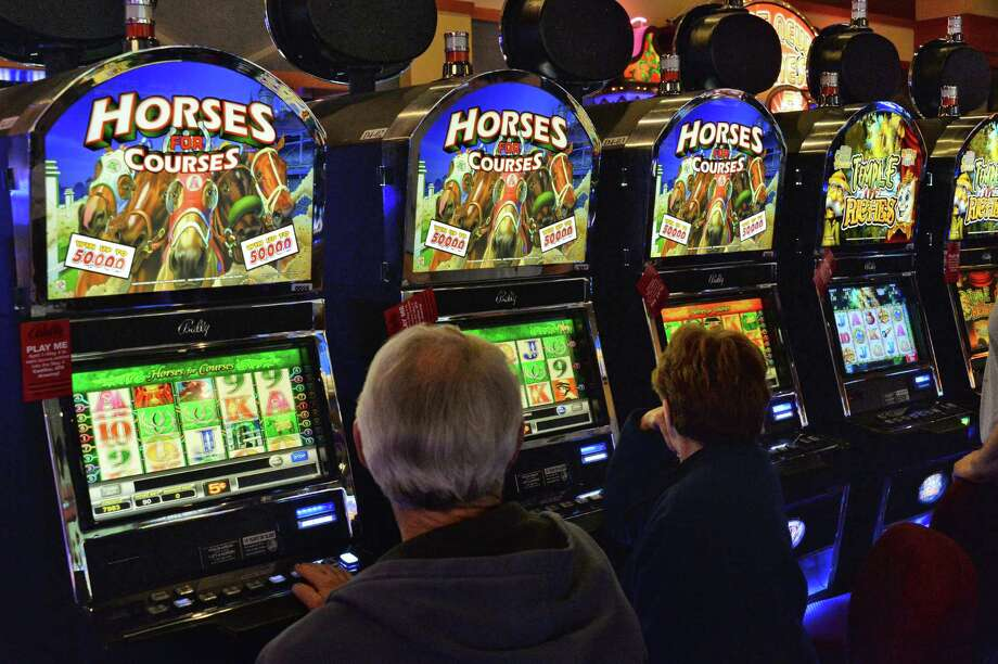 Gamblers try their luck at video gaming in Saratoga Casino and Raceway Tuesday April 22, 2014, in Saratoga Springs, NY.   (John Carl D'Annibale / Times Union) Photo: John Carl D'Annibale / 00026590A