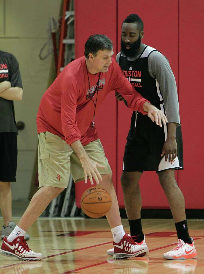 Rockets coach Kevin McHale left, takes a hands-on approach with guard James Harden during Tuesday's practice session at Toyota Center. Photo: James Nielsen, Staff / © 2014  Houston Chronicle