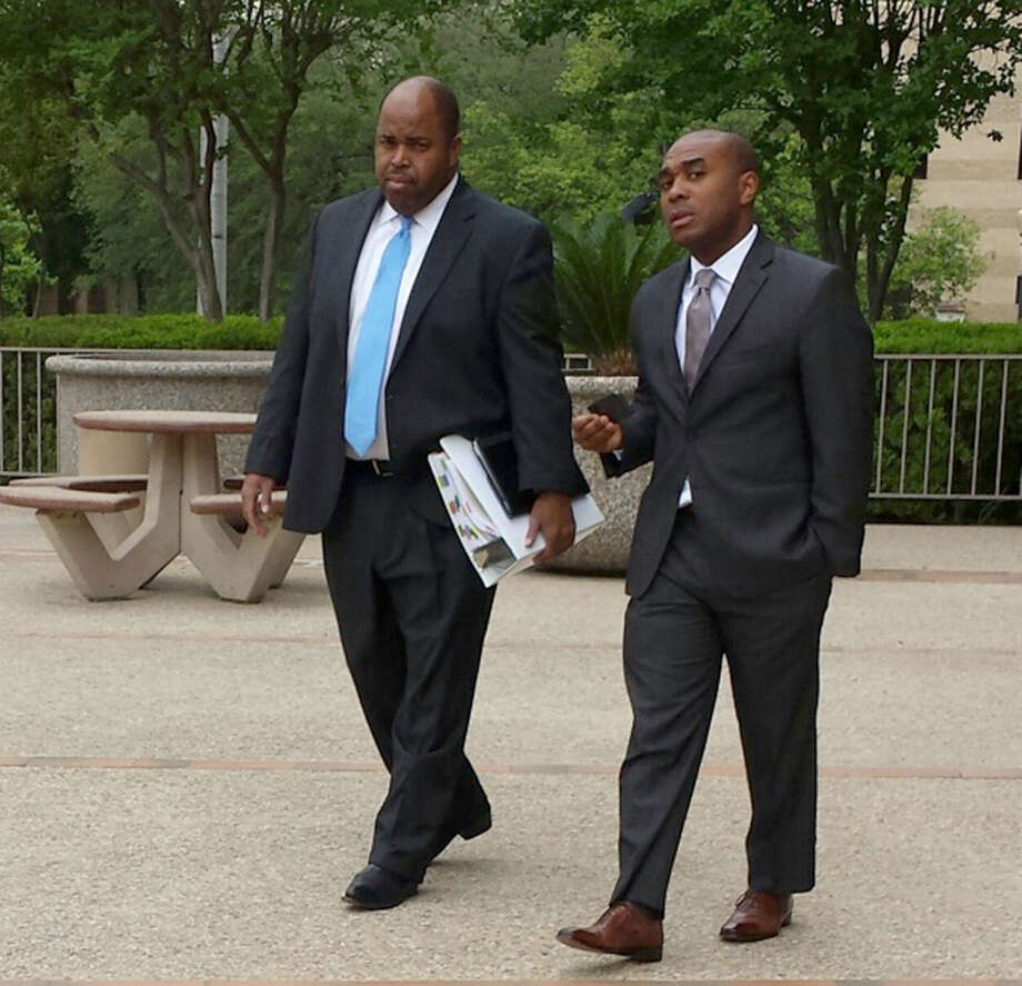 Leonard Roundtree III, right, leaves San Antonio's federal court with his lawyer, Curtis Lilly. Roundtree is on trial on charges that he agreed to help deliver a payment to a hitman his uncle, Alvin Roundtree, allegedly hired to kill his estranged common-law wife. Last June, Alvin Roundtree shot the woman seven times at Joint Base San Antonio'ÇöFort Sam Houston, but she survived. Photo: Guillermo Conteras, San Antonio Express-News / San Antonio Express-News