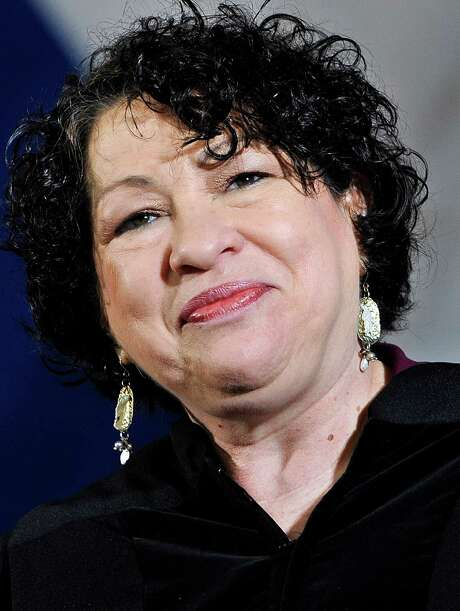 U.S. Supreme Court Justice Sonia Sotomayor smiles after receiving a surprise Honorary Doctor of Laws during commencement at Yale University in New Haven, Conn., Monday, May 20, 2013. (AP Photo/Jessica Hill) Photo: Jessica Hill, FRE / FR125654 AP